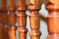 Closeup shot photo of wooden stair railing.