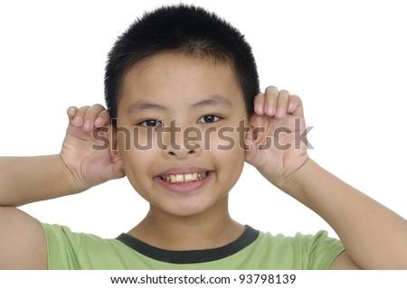 Closeup Smiling human child hand listening deaf ear gossip - stock photo