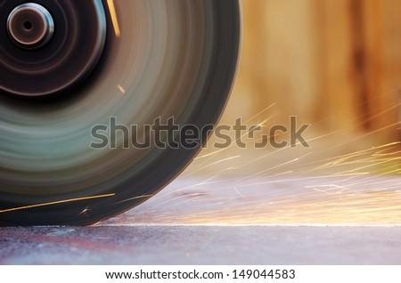 Closeup sparks from abrasive grinder circle