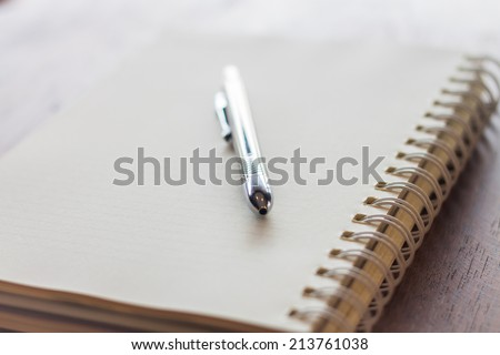 Closeup spiral notebook and pen, stock photo
