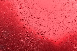 Closeup splashing red wine into glass and bubble many splash flow flood fading out on top of natural rheology fluid and widely sheer liquid focus