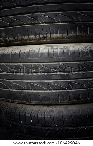 Closeup stack of car tires - stock photo