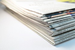 closeup Stack of newspapers on white background