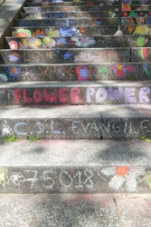 Closeup stairway in Paris, Montmartre , with colorful children chalk paintings