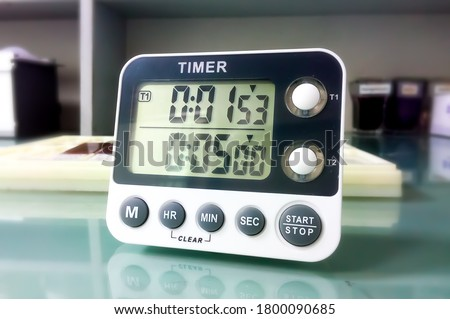 Photo of  Closeup stop watch in laboratory. Timer. Laboratory test time counting concept.Stopwatch.