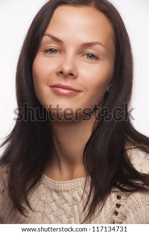 Closeup studio portrait of pretty young woman with long brown hair wearing knitted sweater
