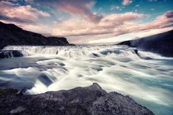 closeup summer waterfall with sundown