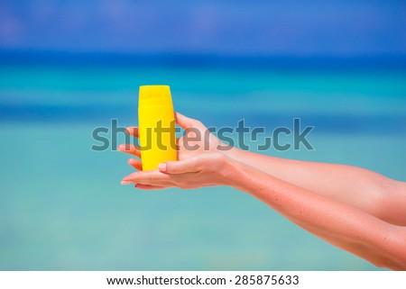 Closeup suncream bottle background blue sea #285875633