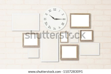 Closeup surface a wall clock show the time in a quarter past ten o'clock with blank frame for decorate on brick wallpaper at wall of house textured background