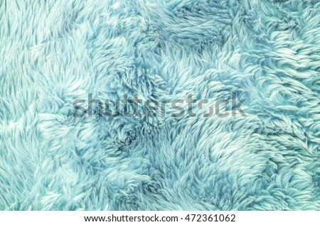 Closeup surface abstract fabric pattern at the light blue fabric carpet at the floor of house texture background #472361062