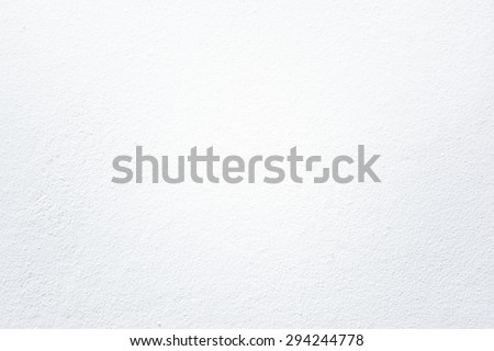 closeup surface detail of white plaster concrete wall texture background with light on top,  bright empty space and rough finishing for backdrop design decoration in architectural material concepts
