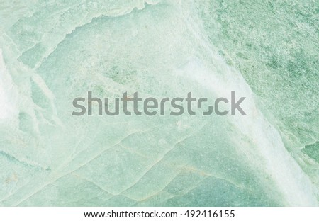 Closeup surface marble pattern at green marble stone wall textured background #492416155