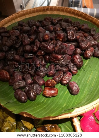 closeup sweet dried date palm fruits or kurma, ramadan (ramazan) food #1108305128