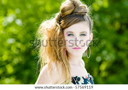 Closeup teenage girl model presenting clothes in the park natural background