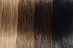 Closeup Texture of A Collection of Different Colors of Pre Bonded Straight Stick Nail Tip (U tip fusion) Human Hair Extensions