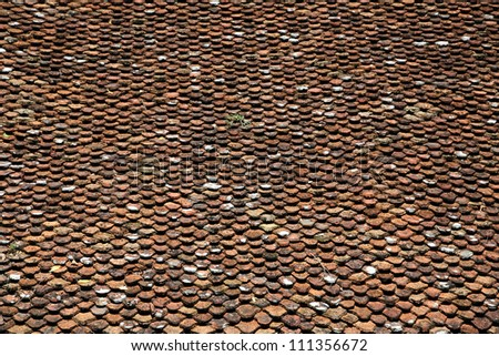 Closeup texture of old red roof tiles