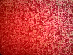 Closeup texture of red paper with chinese letter, good for chinese new year background