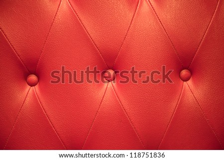 Closeup texture of vintage red leather sofa for background