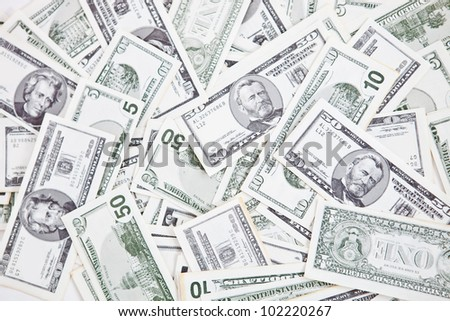 Closeup to a bunch of dollar bills - money concepts
