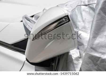closeup to a car mirror with car sun protect covered  #1439715062