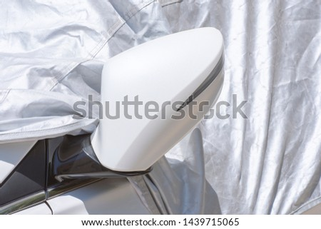 closeup to a car mirror with car sun protect covered  #1439715065