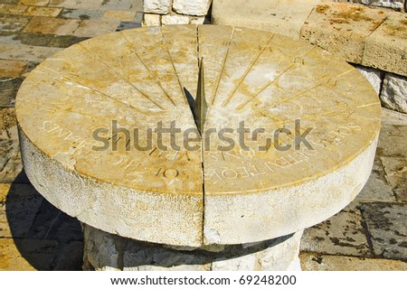 closeup to an old stone sundial