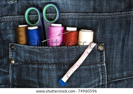 Closeup to jeans pocket with tailor tools