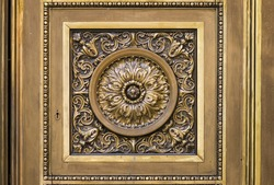 Closeup to the ornament on an antique bronze door of the cathedral of Rosario city, Argentina