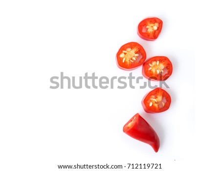 Closeup top view red chili pepper with sliced on white background, raw food ingredient concept