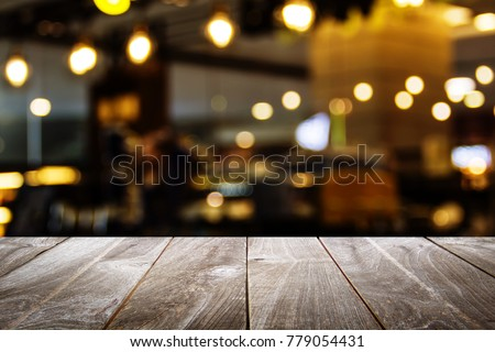 closeup top wood table with Blur Background, for your photo montage or product display, Space for placing items on the table. #779054431