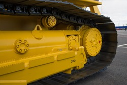 closeup track of a large construction machine.