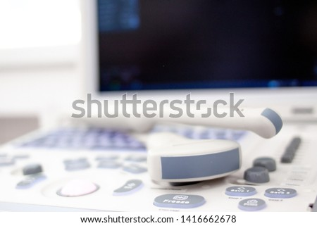 closeup ultrasound scanner equipment in clinic hospital. Diagnostics, sonography and health concept. Copyspace #1416662678
