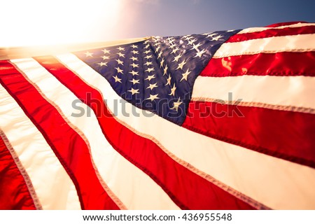 Closeup USA,American flag,the symbolic of liberty,freedom,patriotic,honor,american family,kids,nation,independence day,4th of July,labor day,waving by the wind blow. #436955548
