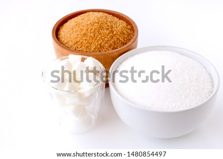 Closeup various types of sugar in bowl isolated on white background. Unhealthy diet ,awareness and stop diabetes concept.