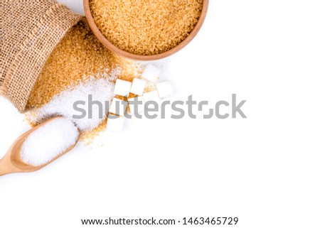 Closeup various types of sugar(sugar cubes,brown granulated sugar and white sand sugar) in bowl,sack bag and spoon isolated on white background. Top view.Flat lay. Copy space for text and content.