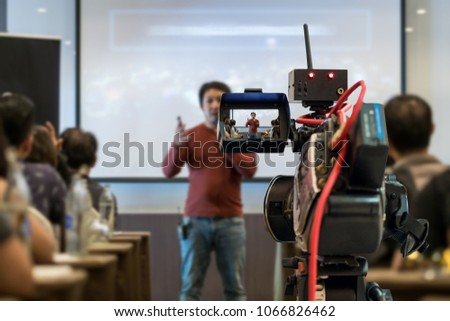 Closeup Video recording the Asian Speaker with casual suit on the stage over the presentation screen in the meeting room of business or education seminar, event and seminar concept #1066826462