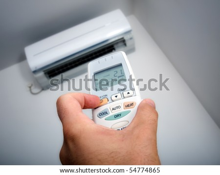 Closeup view about using some appliance such as air condition. - stock photo
