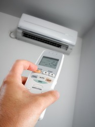 Closeup view about using some electric fixture  such as air condition.