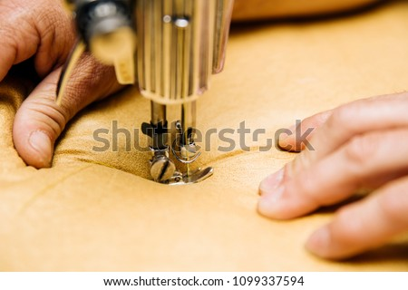 Closeup view at the upholstery sewing machine - Shutterstock ID 1099337594