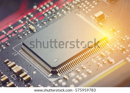 Closeup view of a central processing unit or CPU on electronic board. CPU is electronic circuit within a computer that caries out the instructions of a computer program by performing basic arithmetic. #575959783