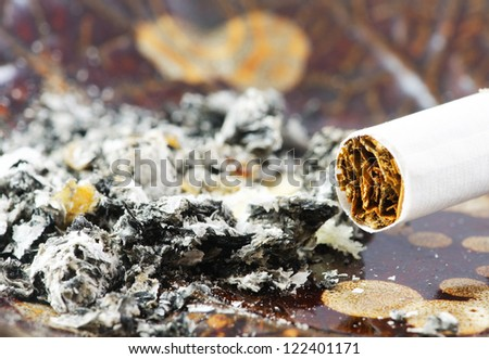 Closeup view of a cigarette and ash