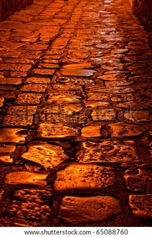 closeup view of a cobblestone street at night