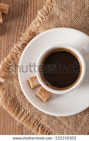 closeup view of a cup of coffee and brown sugar