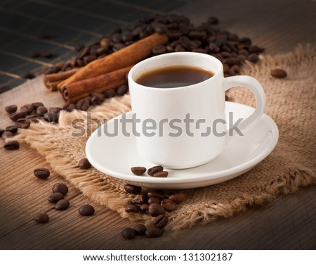 closeup view of a cup of coffee  and coffee beans