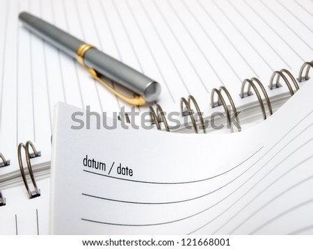Closeup view of a pen and diary book.