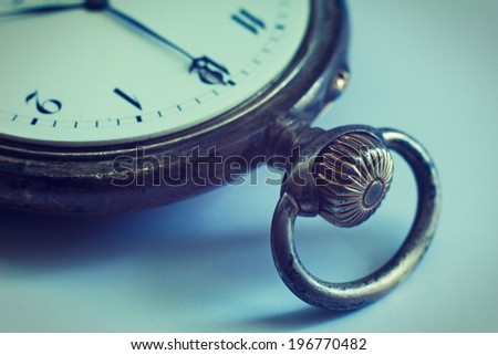 Closeup view of a silver pocket watch. Filtered image:cross processed vintage effect