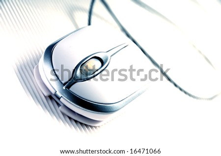 closeup view of a white computer mouse on a white surface