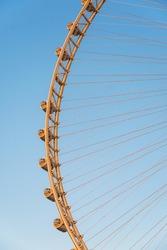 Closeup view of Ain Dubai ferris wheel in blue sky located on Bluewaters Island near Dubai Marina in Dubai, UAE