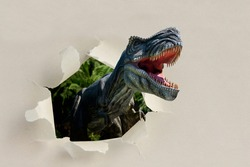 Closeup view of an angry T-Rex dinosaur figurine climbs out of torn paper. Monstrous animal with open mouth and sharp teeth