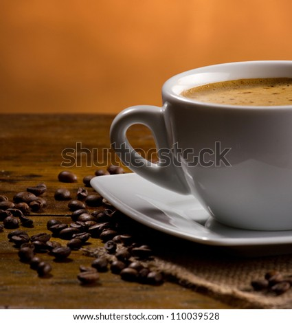 closeup view of an espresso cup on dark background